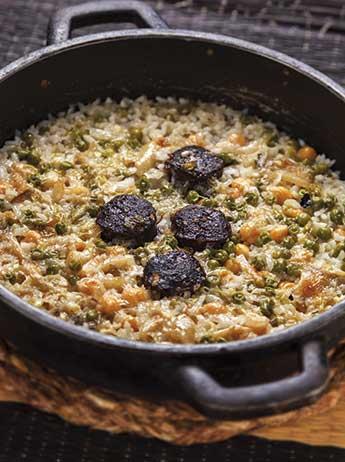 Recepta d'arròs amb bacallà del restaurant Cullera de Boix, especialitzats en arrossos a Barcelona.