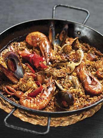 Paella de marisc, l'especialitat del restaurant d'arrossos Cullera de Boix de Barcelona.